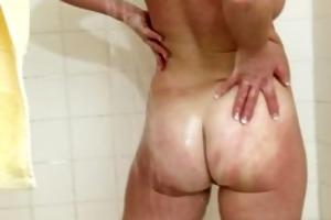 her own cum dripping from her older slit