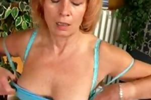 aged redhead is masturbationat home