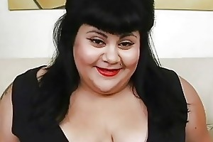overweight dark haired momma with tattoo