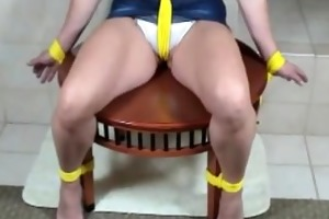 cutie corte gagged and tied constricted to a chair