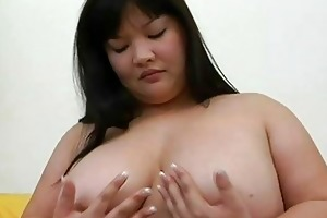 large oriental momma with large love melons plays