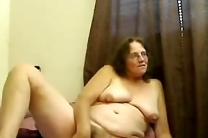 bushy older with glasses bonks her pussy with