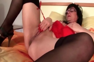 older nympho in nylons fucking herself from behind