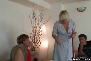 old cleaning woman takes two hard rods