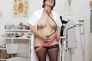 dark brown practical nurse examining her cum-hole
