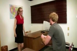 older teacher in spex engulfing student after