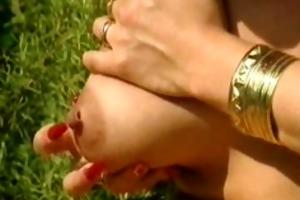 german gal plays with her big pierced nipps