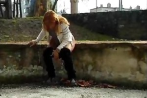 older redhead peeing on the streets with people