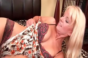 granny in nylons bonks herself with a sex-toy
