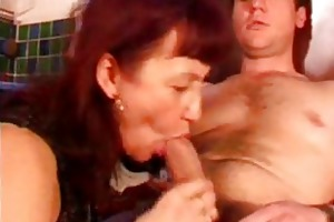 older redhead with darksome stockings sucks cock