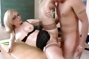 mother i teacher in glasses receives a classroom
