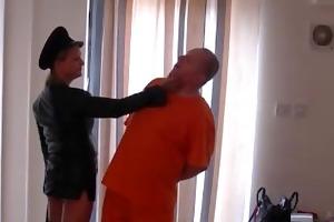 dom leather clad mistresse spanks prisoner slaves