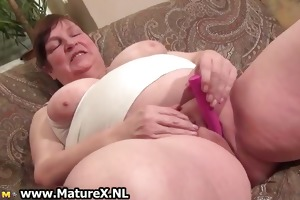 old breasty mamma receives large pink sex-toy