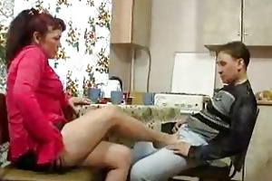 older woman and young lad fucking on kitchen table