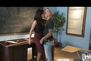 strict brunette hair teacher punishes her student