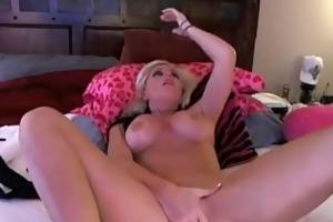 glamorous american blonde fucking herself when