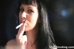 hot dark brown hoe smokes a cigarette