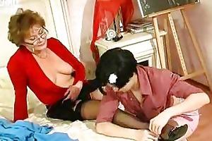 young girl kisses and licks older woman