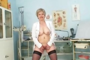 breasty granny in uniform stretching her aged