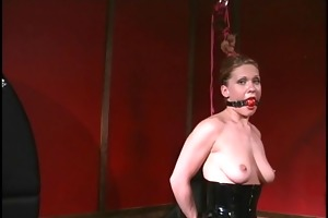 gagged floozy in latex getting a-hole whipped