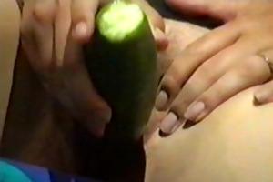 milf enjoyment with a cucumber