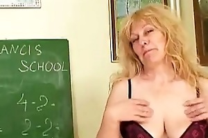 older blond teacher with giant love melons