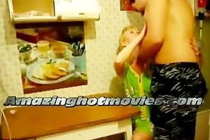 blond woman fucking in the kitchen