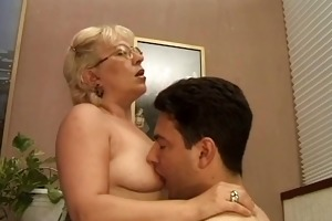 mature dame giving a sex lesson