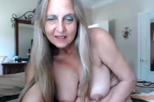 hot breasty aged chick inserts anal plug and rubs