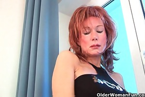 sultry grandma probes her old snatch with a sex